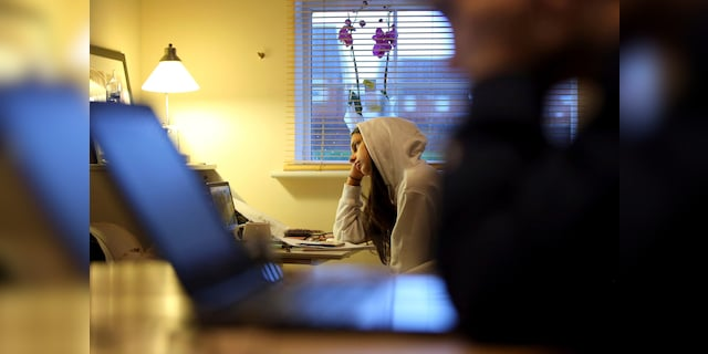 Isla Stanton, 14, begins her home-school lesson via a video link, in Ashford, south England, Tuesday Jan 5, 2021, following new lockdown measures to limit the coronavirus including the closure of schools. The lockdown and home schooling has become a major issue, highlighting the wealth divide with provision of internet connectivity, equipment issues and the impact on upcoming school exams. Prime Minister Boris Johnson has set out further measures including closure of schools as part of a seven week lockdown period in a bid to halt the spread of the coronavirus. (Gareth Fuller/PA via AP)