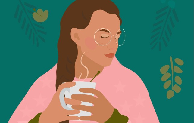 Сute girl with braid holds cup with a hot drink in her hands.There is steam from a mug with tea, cacao or coffee.Cozy autumn mood.