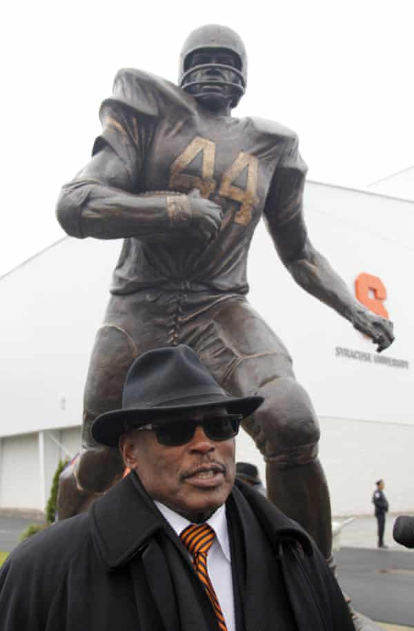 Floyd Little with a statue of himself at Syracuse University.