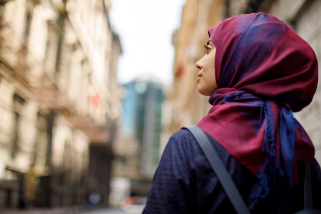 Muslim tourist exploring city