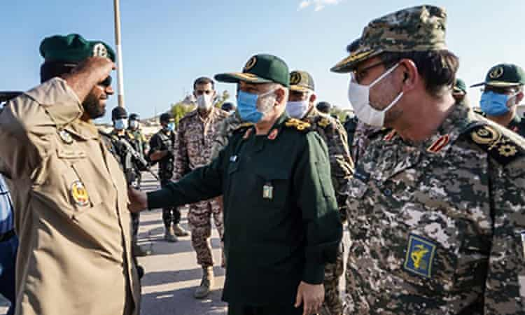 Hossein Salami (centre), with Rear Admiral Alireza Tangsiri, inspects troops during his visit to the island of Abu Musa