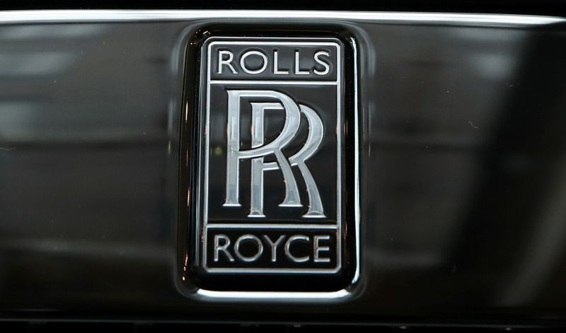 © Reuters. The badge of a Rolls-Royce Black Badge Dawn car is seen at a dealership in London