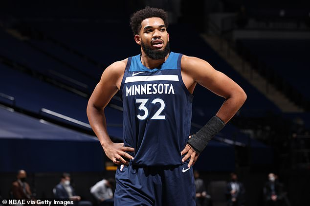 Pushing through: Minnesota Timberwolves star Karl-Anthony Towns announced that he tested positive for COVID-19 over Twitter on Friday; seen on January 13