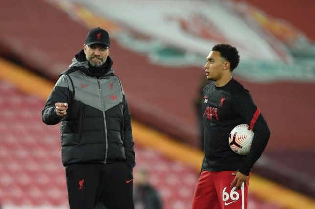 Liverpool's German manager Jurgen Klopp (L) talks with Liverpool's English defender Trent Alexander-Arnold (R) during the warm up of the English Premier League football match between Liverpool and Sheffield United at Anfield in Liverpool, north west England on October 24, 2020.