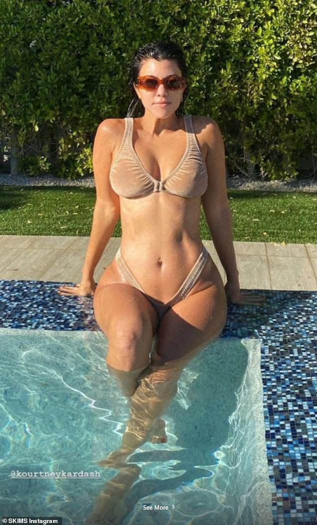 Kourtney Kardashian left very little to the imagination as she showcased her ample assets in a busty throwback snap, which featured her sitting poolside on Saturday