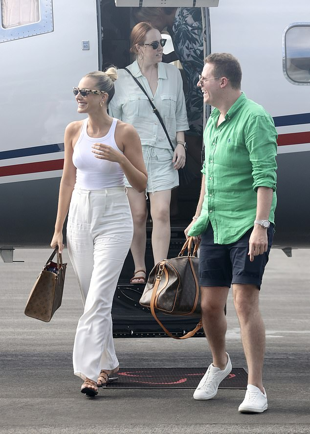 Arriving in style: Model Laura Dundovic (left) made quite an entrance as she arrived back in Brisbane following a week-long holiday on Hamilton Island