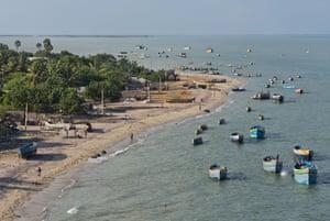 Fishing boats and fishers' huts on the beach at Rameswaram.