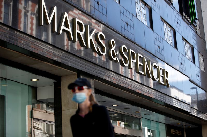 © Reuters. A woman walks past a M&S store at Oxford Street in London