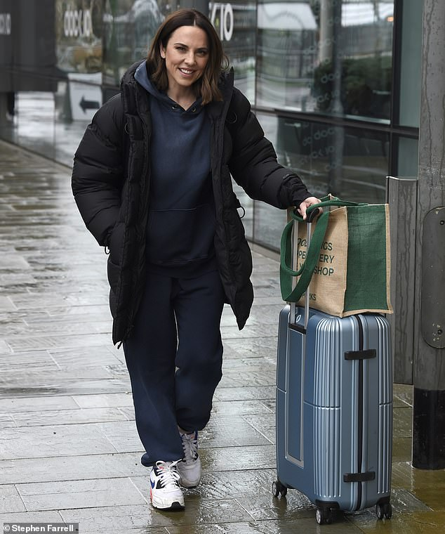 Cheery:Mel C cut a low-key figure as she stepped out in Salford, Manchester, on Saturday after leaving MediaCityUK