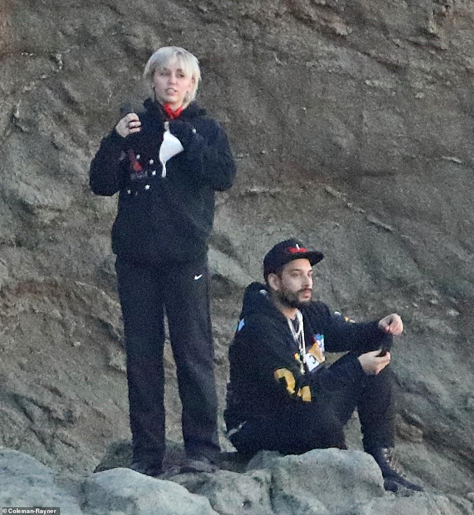 Idyllic:Miley Cyrus had an idyllic Friday as she watched the sunset on the beach in Malibu
