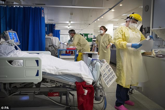 Hospitals across England are seeing more coronavirus patients than they did in the first wave in 2020 (Pictured: Staff in an intensive care ward in St George's Hospital in London)