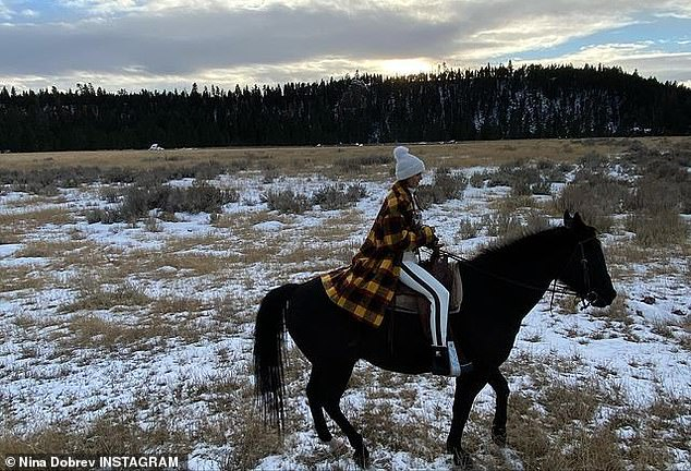 Going rural: Nina Dobrev has been posting regular updates from her Montana vacation, and shared a couple of snaps showing her on horseback on Monday