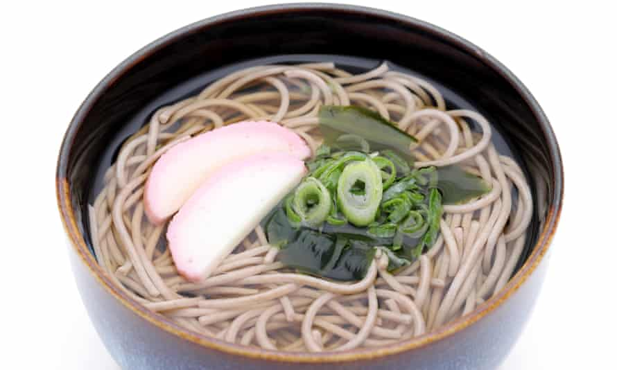 Japanese Kake soba noodles in a ceramic bowl.