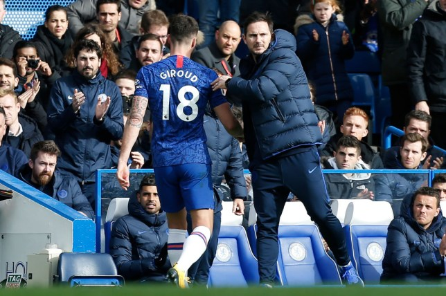 Chelsea's English head coach Frank Lampard (R) substitutes Chelsea's French striker Olivier Giroud during the English Premier League football match between Chelsea and Tottenham Hotspur at Stamford Bridge in London on February 22 2020