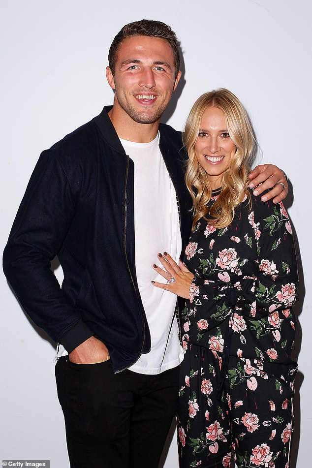 Over: Phoebe Burgess is officially divorced from Sam Burgess after five years of marriage, a new report claims. The pair are pictured in happier times, in May 2017