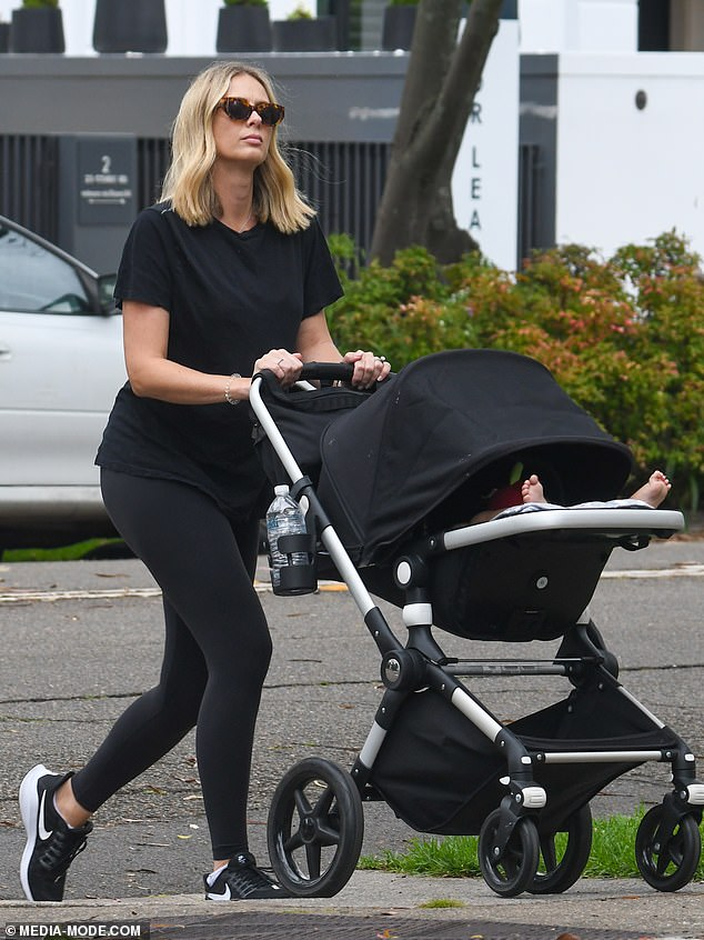 Out and about: On New Year's Day on Friday, pregnant Sylvia Jeffreys was spotted on a walk in Sydney with son Oscar, 10 months