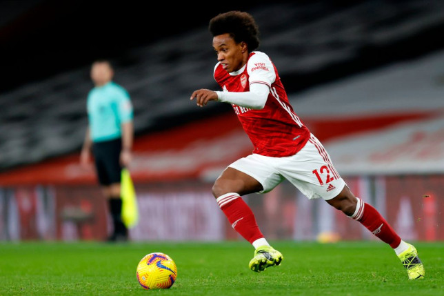 Willian runs with the ball during Arsenal's Premier League clash with Manchester United