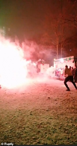 A large explosion from a firework creates a bright slark