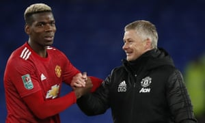 Paul Pogba (left) and the Ole Gunnar Solskjær celebrate a victory at Everton.