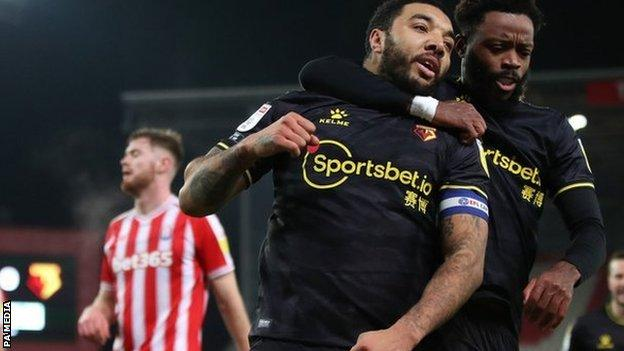 Troy Deeney's second penalty of the week set Watford on their way to victory at Stoke