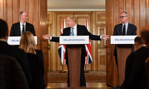 Johnson with England's chief medical Officer, Chris Whitty (left), and his chief scientific adviser, Patrick Vallance at a press conference on 19 March.