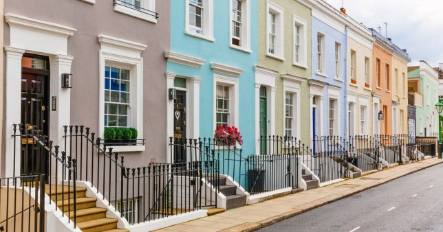 A row of houses on a street with colourful paint