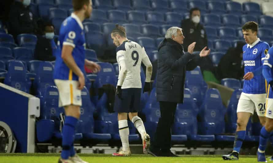 Tottenham's Gareth Bale walks past the club's manager, José Mourinho, after being substituted just after the hour.