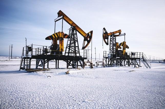 Oil rig, snow winter, oil pump