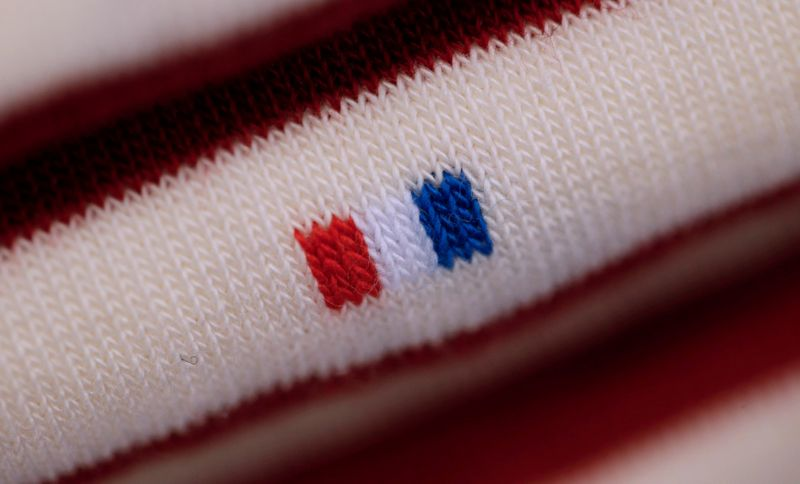 © Reuters. FILE PHOTO: A French flag is seen on a pair of socks displayed at the