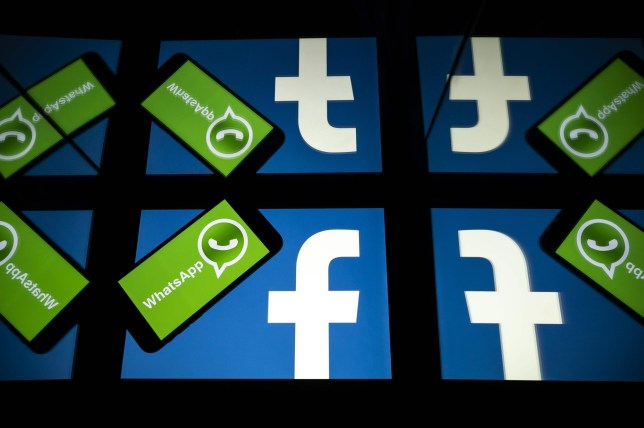 (FILES) In this file photo taken on October 05, 2020 the logo of US social network Facebook and mobile messaging service WhatsApp are seen on the screens of a smartphone and a tablet in Toulouse, southwestern France. - US federal and state antitrust enforcers filed suit against Facebook on December 9, 2020 claiming the social media giant abused its dominant position with its acquisitions of messaging services Instagram and WhatsApp. (Photo by Lionel BONAVENTURE / AFP) (Photo by LIONEL BONAVENTURE/AFP via Getty Images)