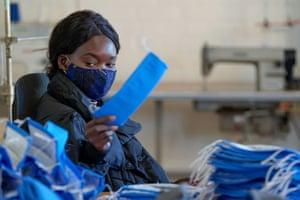Nancy Oziya, a social sewing teacher at The Social Studio, makes masks in Melbourne.