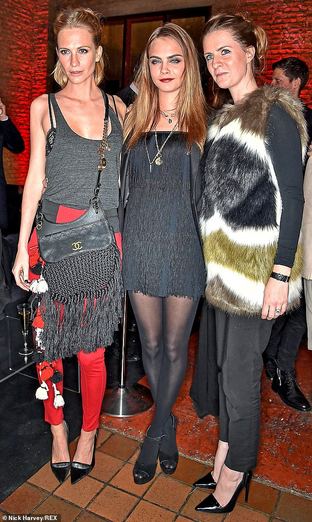 While millions were forced to cancel long-planned celebrations with family elsewhere in the country, Cara Delevingne enjoyed a Christmas fit for an aristocrat. I hear the top model and actress's father, Charles, hired a Palladian mansion in Oxfordshire for a lavish party for four generations of their family, complete with staff to deal with the more mundane tasks of seasonal cooking and cleaning. Above, Cara with her sisters, Poppy (left) and Chloe (right)
