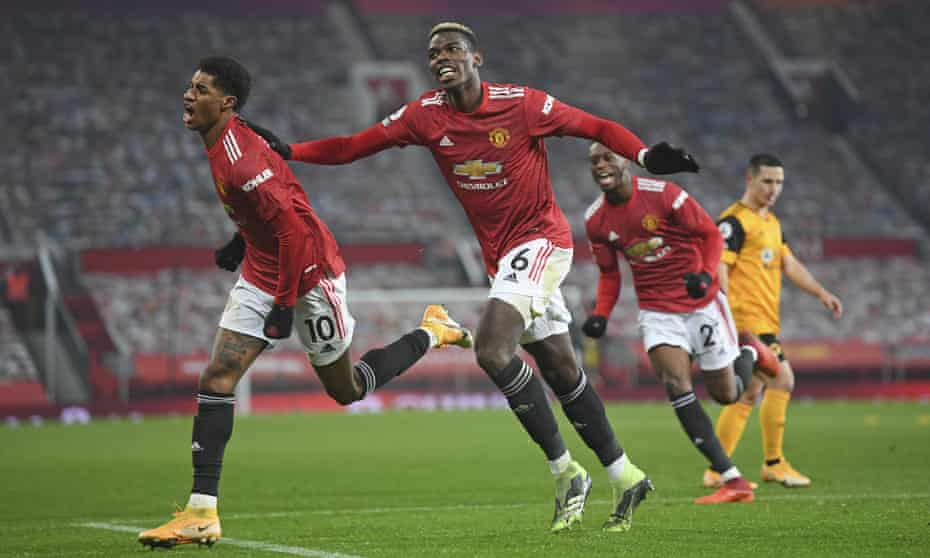 Rashford celebrates with Paul Pogba after scoring the winning goal late in the match against Wolves at Old Trafford on Tuesday.