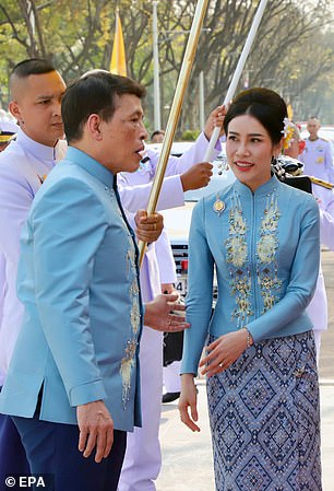 The pair wore matching blue coats as they took part in a Buddhist ceremony to mark the occasion at Waskuri pier in Bangkok