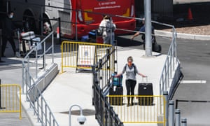 Arriving passengers at Sydney's Kingsford Smith International airport are sent onto buses for mandatory 14 day quarantine on January 22, 2021 in Sydney, Australia.