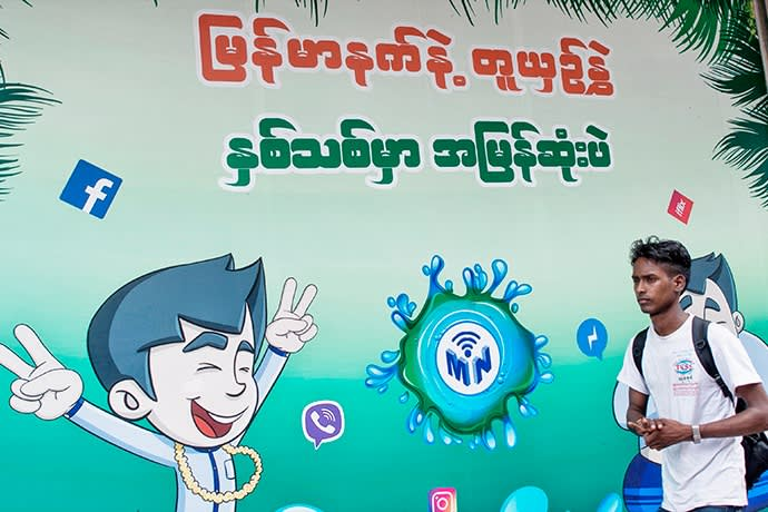 The Facebook logo is seen on an advertisement by a local telecom company in Yangon on June 7, 2018. - Facebook has blacklisted a group of Myanmar Buddhist hardliners including monks notorious for bilious hate speech against Rohingya Muslims, the company said June 7, as it scrambles to show it is tackling inflammatory content. (Photo by Ye Aung THU / AFP)