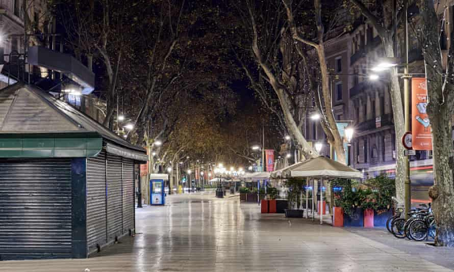 A normally busy street remains empty in Barcelona, Spain.