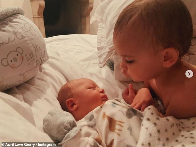 Tender:Days later, April captured a tender moment between youngest daughter Lola and baby Luca, writing: 'My heart is so full!'