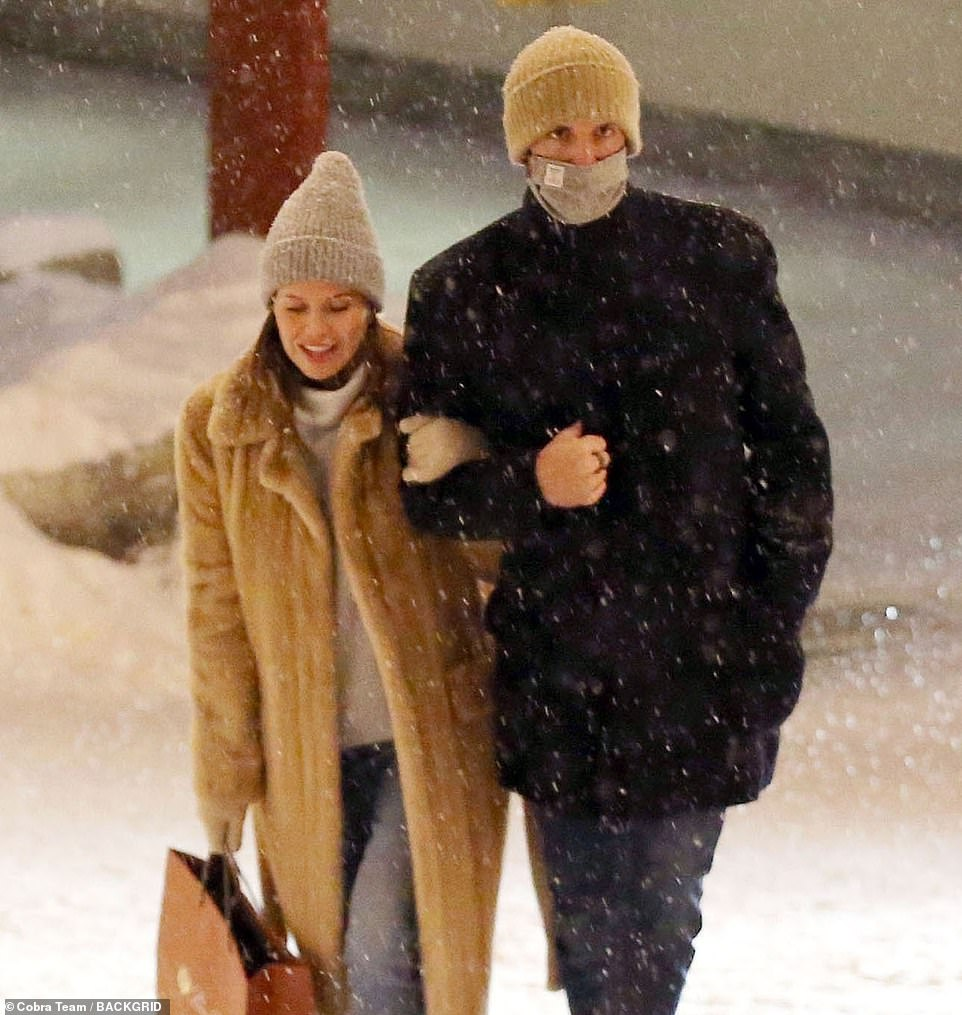Wrapped up: Any hint of a baby bump was hidden under Dasha's chic winter ensemble