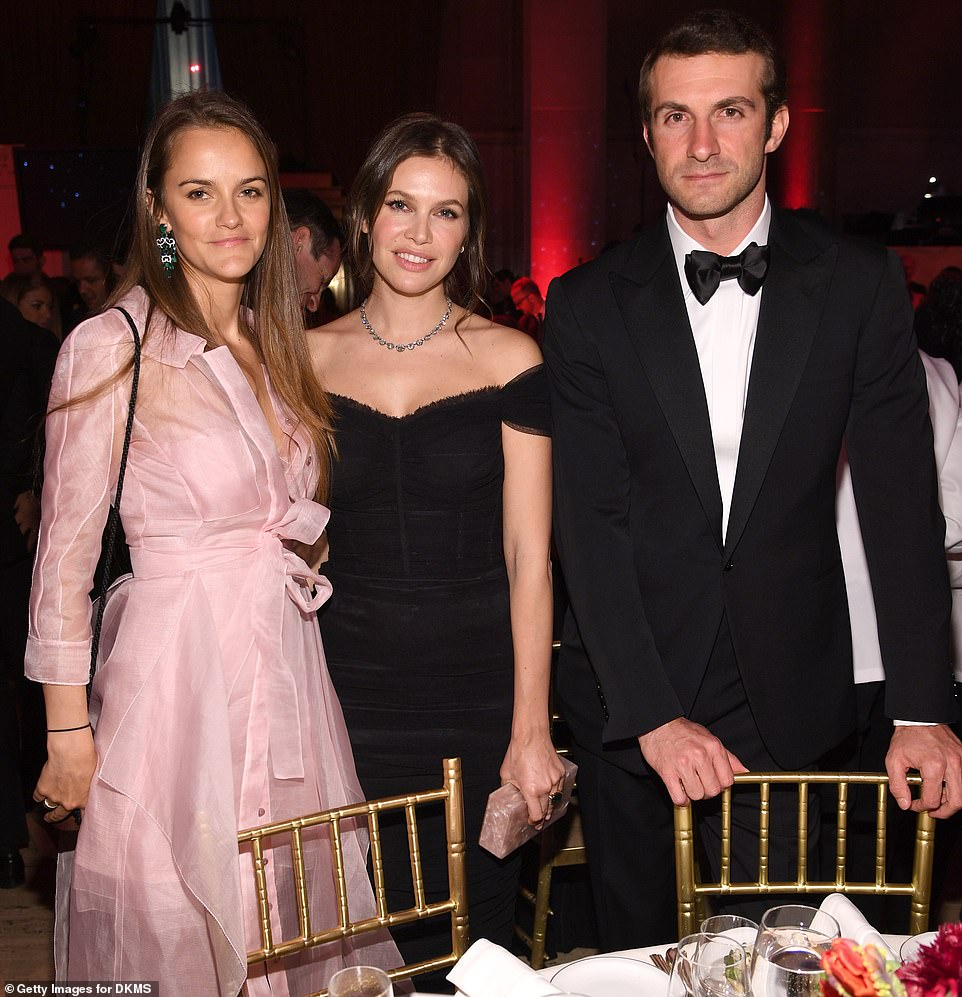 Black tie: Dasha, centre, with Stavros and Charlotte Santo Domingo, at a New York gala in 2018