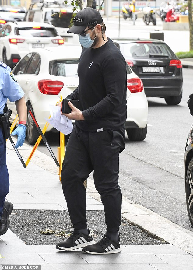 Sleek:He wore a black jumper and trousers, and kept things casual with a pair of Adidas sneakers and a baseball cap