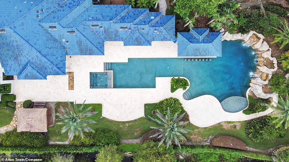 Enormous: It opens up into a wider resort-style pool that includes a waterfall and a dock for boating on the lake