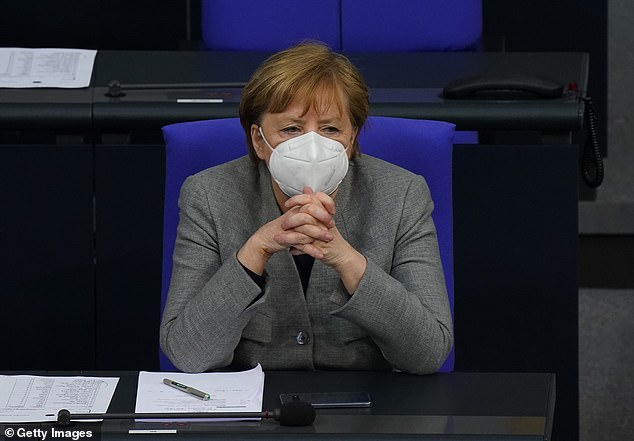Angela Merkel, pictured in the German parliament on Wednesday, is expected to push for tougher restrictions next week amid persistently high infection rates in the country