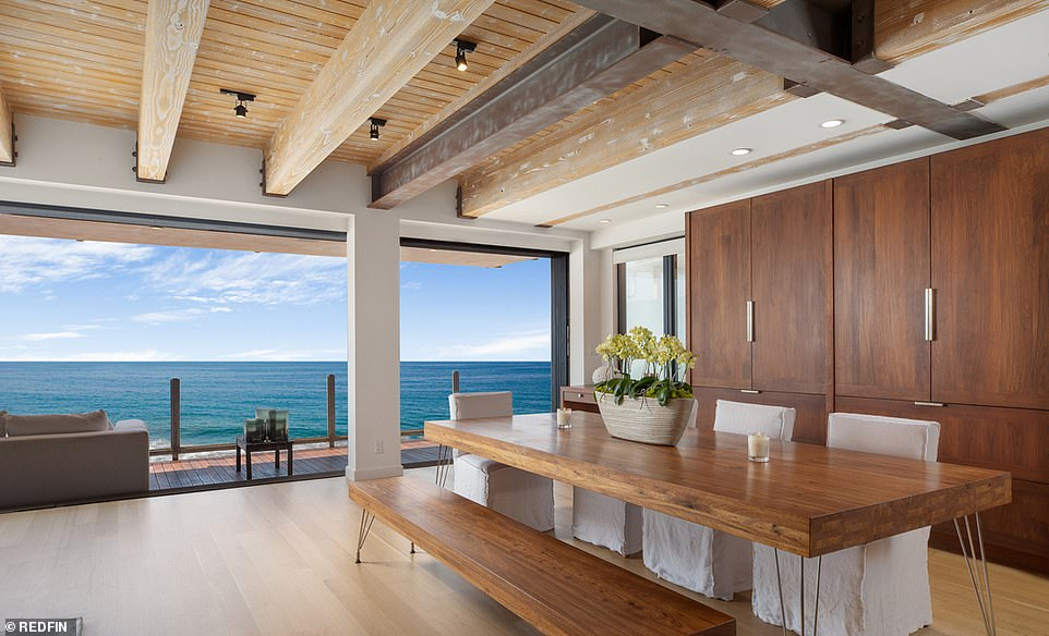 Wooden details: Equally spacious throughout, the open-format interior features hardwood floors and wooden ceilings with exposed beams