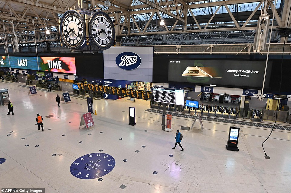 Streets and city centres were quiet as Britons digested the new restrictions being placed on their lives. PIctured, Waterloo station in London