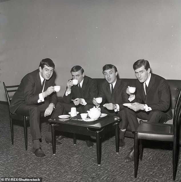 Tea for four: The band are snapped backstage at the Sunday Night At The Prince Of Wales TV show at Christmastime 1963
