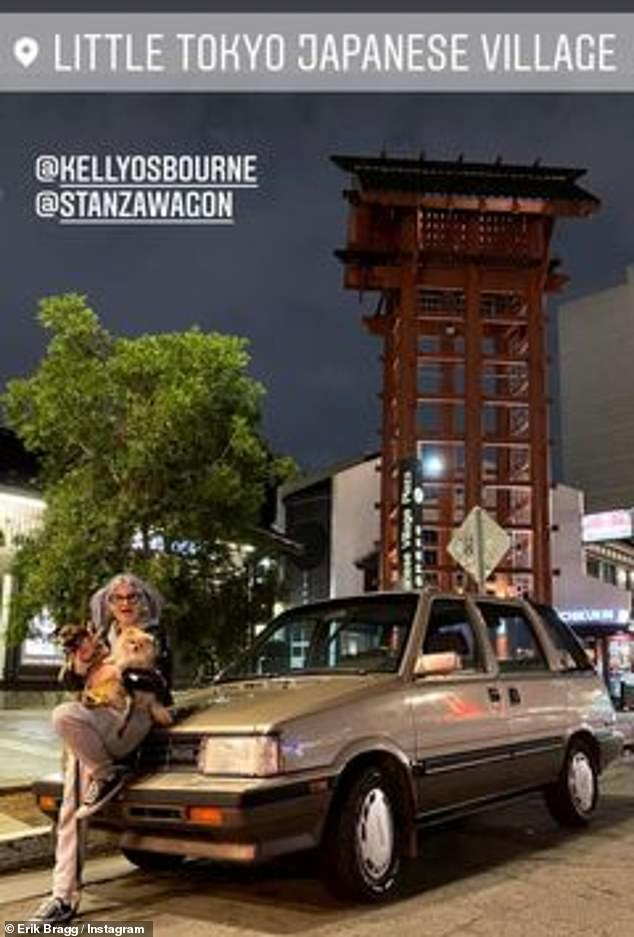 Posing on a station wagon: Their outing included a jaunt to the Little Tokyo area of Downtown Los Angeles, as seen on Erik's Instagram story