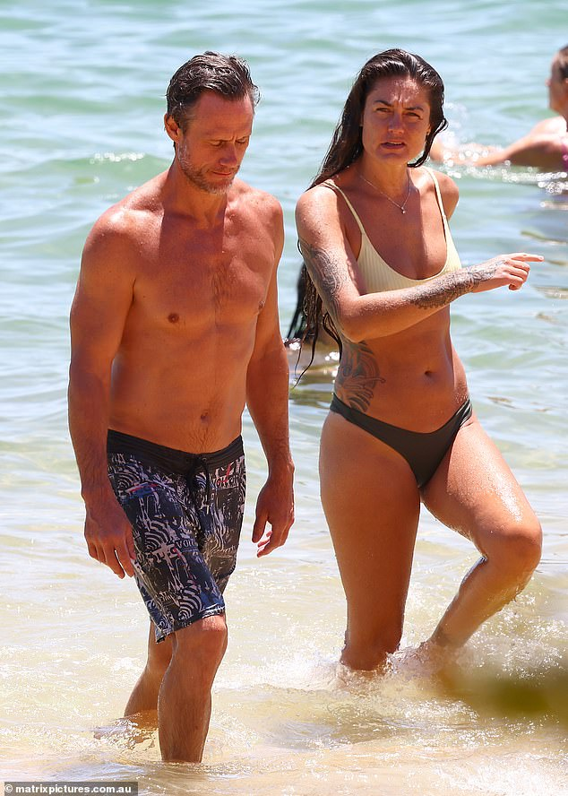 Beach babe: Gabriella flaunted her amazingly-toned figure in mismatched swimwear