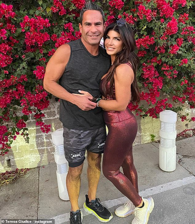 They can't keep their hands off each other:Teresa then shared another photo where they were arm in arm while on a sidewalk in front of a wall of bright bougainvillea