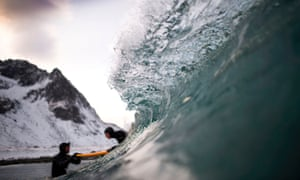 A beginner taking a surfing lesson near Unstad, Norway.